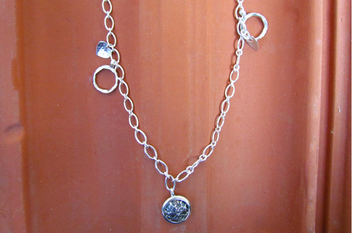 <b>SH112</b> - Sterling silver necklace with various elemnts